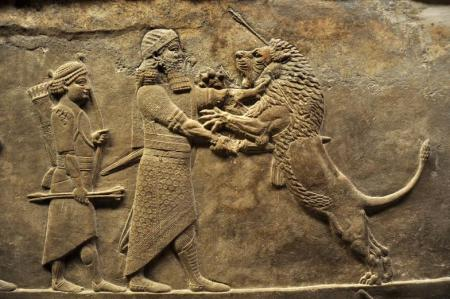 King Ashurbanipal engages a lion in hand-to-paw combat.