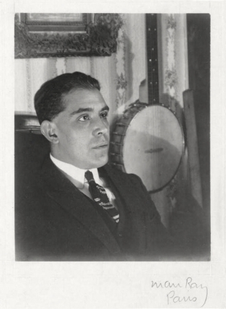 Juan Gris, photographed by Man Ray (1922).