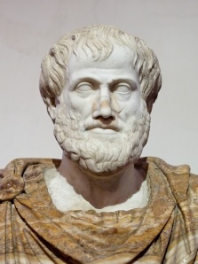 This marble bust of Aristotle is a Roman copy of a Greek bronze original by Lysippos, c. 330 BCE.  The alabaster mantle is modern.