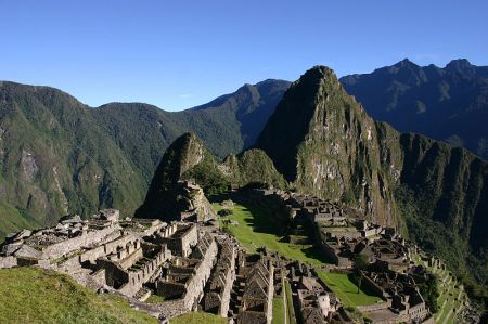 The ruins of Machu Picchu lie nestled in the high Peruvian Andes.