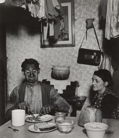 Northumbrian Miner at His Evening Meal is a photograph by Bill Brandt.