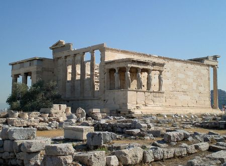 The Erechtheion was a temple located on the Acropolis that was dedicated to both Athena and Poseidon.