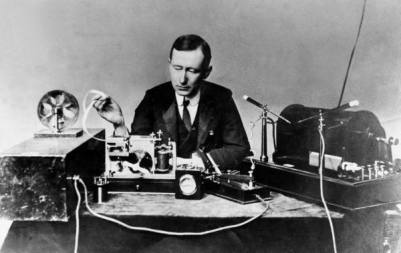 Guglielmo Marconi in 1901, re-enacting the first wireless signal.