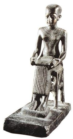 Bronze statue of Imhotep in the Louvre (c. 330 BCE).