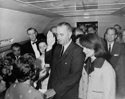 Lyndon Johnson taking the oath of office on Air Force One, shortly after the assassination of President Kennedy, November 1963.