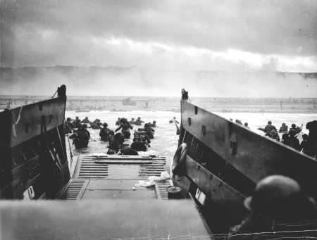 Allied troops land at Normandy on D-Day.