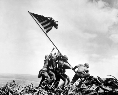 Raising the Flag on Iwo Jima is a photograph by Joe Rosenthal.