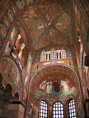 The interior of San Vitale is highlighted by its dramatic arches and stunning mosaics.