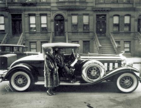 Harlem Couple in Raccoon Coats, a photograph by James Van Der Zee.