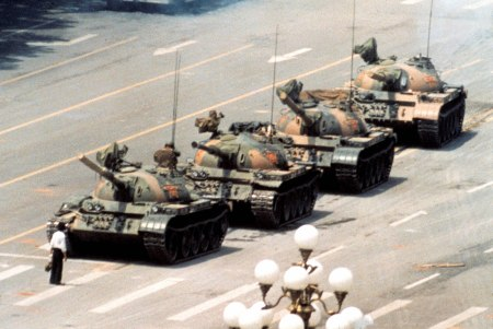 Tank Man, a photo by Jeff Widener of a man who tried to stop tanks at Tienenman Square.