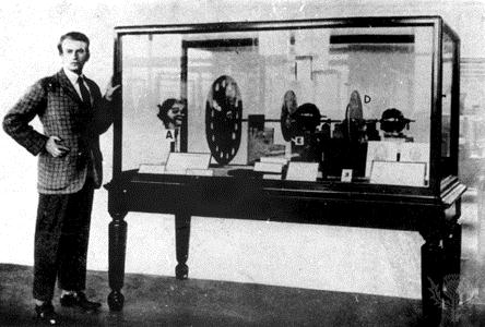 John Logie Baird, with one of his earliest television systems. In the end, it was the electronic path of Zworkin and Farnsworth that carried the day.