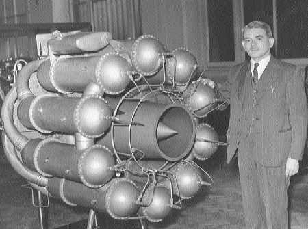 In an undated photo, Frank Whittle stands next to the prototype of his jet engine.