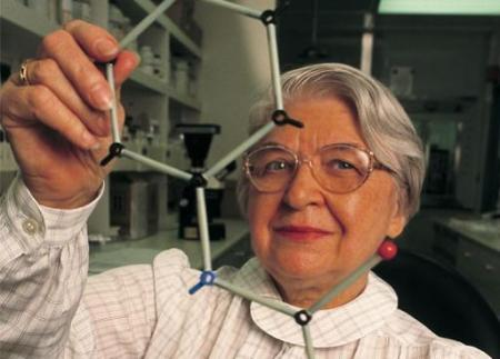 Kevlar inventor Stephanie Kwolek holds a model of the polymer she synthesized.