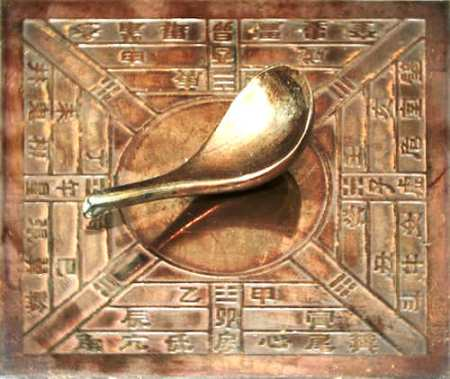 The first Chinese compasses used a spoon on a flat board. It is not clear if this image shows an actual Han Dynasty compass or a reproduction.