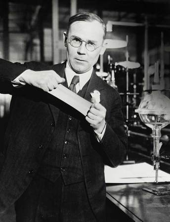 Wallace Carothers demonstrates the strength of his invention, nylon.