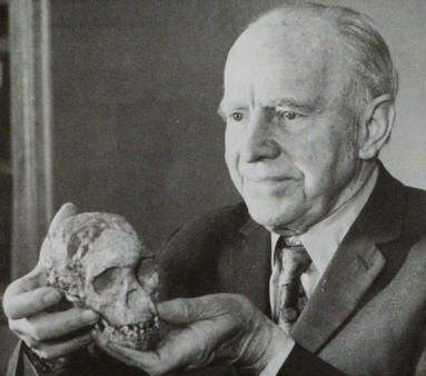 Raymond Dart (1893-1988) with the Taung Child skull.