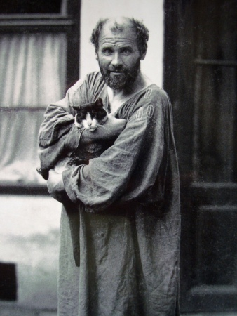 A 1912 photograph of Gustav Klimt and his cat in Vienna.