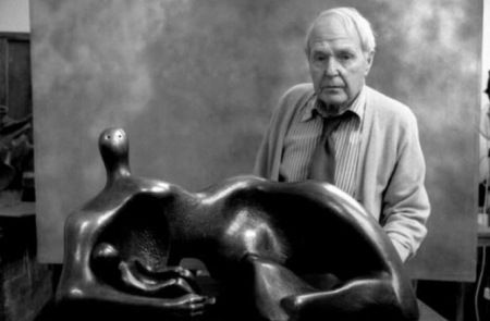 An undated photograph of Henry Moore with one of his sculptures.
