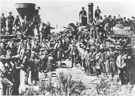 """""""East and West Shaking Hands at Laying of Last Rail,"""" a photograph taken at Promontory Summit, Utah, on May 10, 1869 by Andrew J. Russell."""