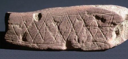 Etchings on an ochre stone found in Blombos Cave in South Africa.