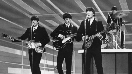 The Beatles perform on the Ed Sullivan Show in February 1964.