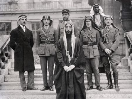 Emir Feisal and his party (including T.E. Lawrence) at Versailles.