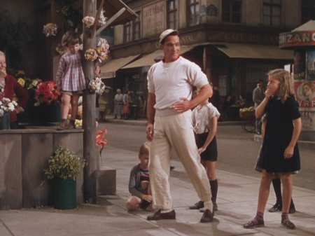 A still image from the I Got Rhythm sequence of An American in Paris, with Gene Kelly.