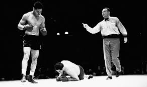 Joe Louis (standing) and Max Schmeling (not standing).