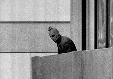 A terrorist stands guard at the Munich Olympics.