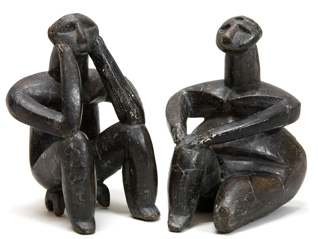 thinker and sitting woman