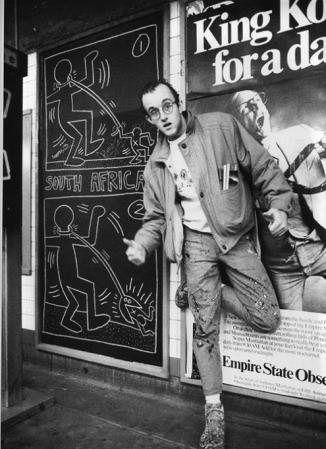 Keith Haring, c. 1978, with one of his chalk subway drawings.