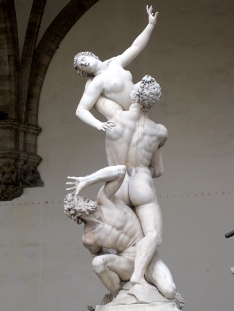 The Rape of the Sabine Women, by Giambologna, is located in the Loggia dei Lanzi, Piazza della Signoria, in Florence, Italy.