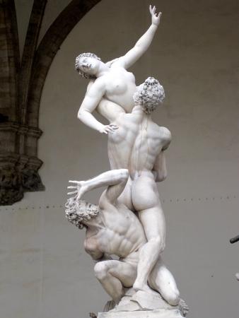The Rape of the Sabine Women, by Giambologna, is located in the Loggia dei Lanzi, Piazza della Signoria, in Florence, Italy.
