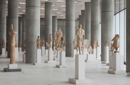 An exhibit hall of the Acropolis Museum in Athens, with Kritios Boy in the foreground.