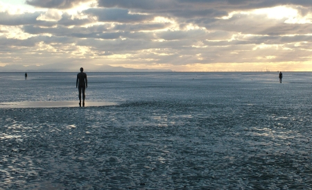 Antony Gormley's Another Place is installed at Crosby Beach in ___, UK.