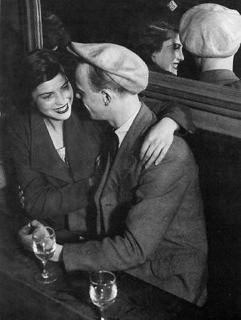 Couple d'Amoureau Assis, Bal Musette des Quatre Saisons, Rue de Lappe is a photograph by Brassaï .
