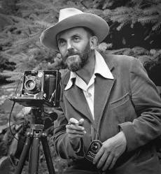 A photograph of Ansel Adams by J. Malcolm Greany, c. 1950.