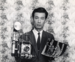An undated photograph of Yasushi Nagao with a print of his prize-winning photo.